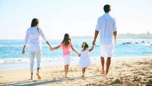 Photo of Family Walking on the Beach
