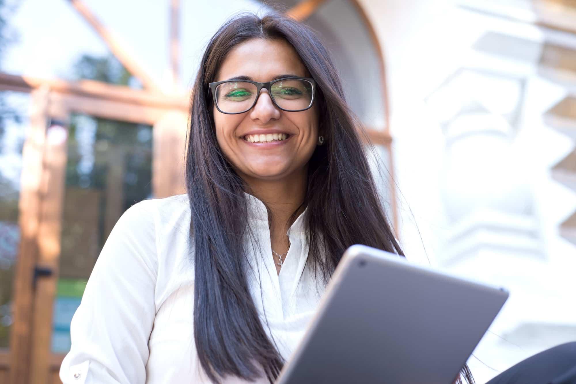 Revenue - Unlock Increased Cash Flow 1 woman smiling at camera min